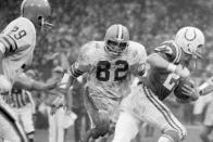 FILE - In this Dec. 26, 1971, file photo, Cleveland Browns linebacker Jim Houston (82) chases after Baltimore Colts wide receiver Ray Perkins during a football game in Cleveland. Houston's widow would keep notes on her husband's deteriorating condition in a three-ring binder so she would be prepared for the day when he needed full-time care. (AP Photo/FIle)
