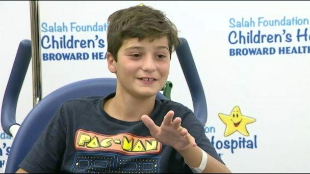 PHOTO: Christian Mariani spoke to the press after being attacked by a shark. (WPLG)