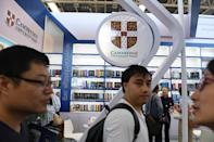 """Rita Yan, a CUP coordinator at the publisher's booth, told AFP that the censorship issue """"wasn't affecting our activities at the book fair."""" (AFP Photo/Greg Baker)"""
