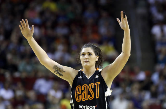 FILE - In this July 22, 2017 file photo, Chicago Sky's Stefanie Dolson raises her hands in the second half of the WNBA All-Star basketball game in Seattle. Dolson says she tested positive for the cororavirus. She is the first known Chicago professional athlete and the second WNBA player known to have contracted COVID-19. Dolson announced that she caught the virus in a video that aired Friday, April 17, 2020 during ESPN's broadcast of the WNBA draft.(AP Photo/Elaine Thompson, File)