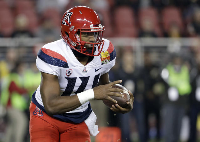 "Arizona quarterback <a class=""link rapid-noclick-resp"" href=""/ncaaf/players/263219/"" data-ylk=""slk:Khalil Tate"">Khalil Tate</a> runs against Purdue during the first half of the Foster Farms Bowl NCAA college football game Wednesday, Dec. 27, 2017, in Santa Clara, Calif. (AP Photo/Marcio Jose Sanchez)"