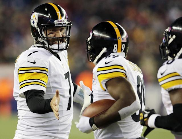 Pittsburgh Steelers quarterback Ben Roethlisberger (7) celebrates his touchdown pass to Jerricho Cotchery, center, in the third quarter of an NFL football game against the New England Patriots, Sunday, Nov. 3, 2013, in Foxborough, Mass. (AP Photo/Charles Krupa)