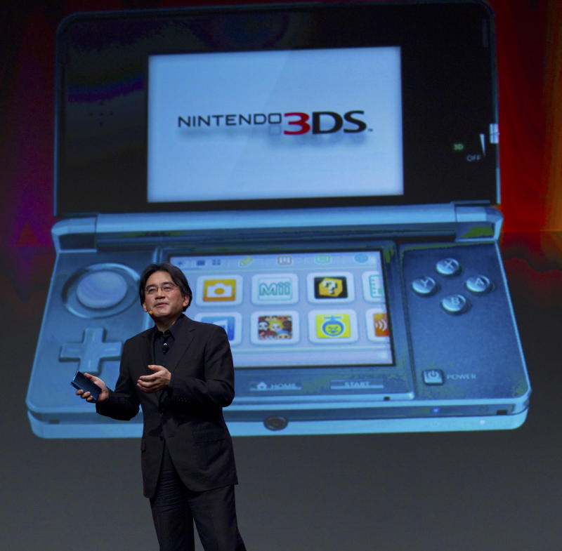 In this photo provided by Nintendo of America, Satoru Iwata, president of Nintendo Co. Ltd., showcases the Nintendo 3DS portable video game system at the Game Developers Conference in San Francisco on Wednesday, March 2, 2011. The Nintendo 3DS launches in the United States on March 27, 2011. (AP Photo/Nintendo of America, Kim White) NO SALES