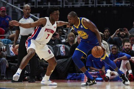 Dec 8, 2017; Detroit, MI, USA; Golden State Warriors forward Kevin Durant (35) dribbles defended by Detroit Pistons forward Stanley Johnson (7) in the second half at Little Caesars Arena. Mandatory Credit: Rick Osentoski-USA TODAY Sports