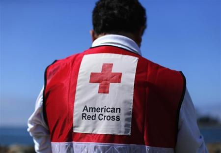 An American Red Cross official participates in a mock rescue drill simulating a boating accident in waters off the coast of San Diego