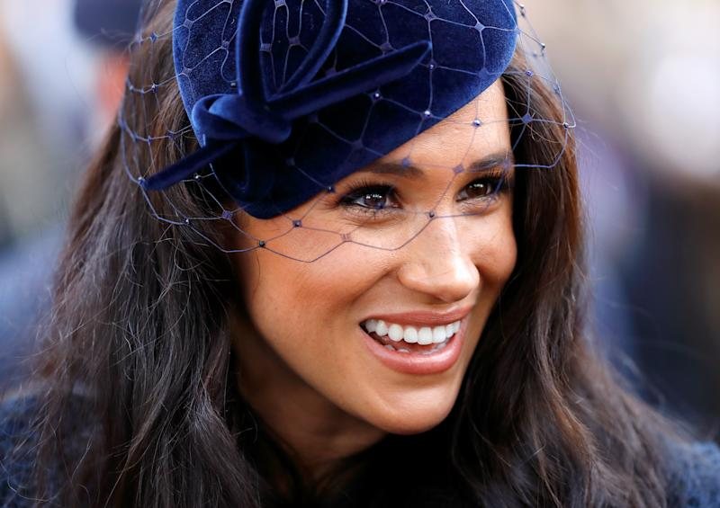Meghan, Duchess of Sussex wears a blue hat and coat at the 91st Field of Remembrance at Westminster Abbey on November 7, 2019 in London, England.