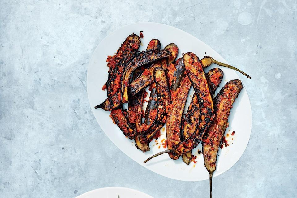 """Japanese eggplants are smaller, sweeter, and faster-cooking than other types. Which means they're great for the grill. A quick curry paste gives this dish a ton of flavor. <a href=""""https://www.epicurious.com/recipes/food/views/red-curry-marinated-japanese-eggplant?mbid=synd_yahoo_rss"""" rel=""""nofollow noopener"""" target=""""_blank"""" data-ylk=""""slk:See recipe."""" class=""""link rapid-noclick-resp"""">See recipe.</a>"""