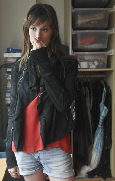 This Aug. 15, 2012 photo shows model Elettra Wiedemann wearing her favorite coat at her apartment in New York. Wiedemann, daughter of Isabella Rossellini, landed on this year's Vanity Fair's International Best-Dressed dressed list. She's now keeping company with the Duchess of Cambridge, Diane Kruger and Jay-Z. (AP Photo/Bebeto Matthews)