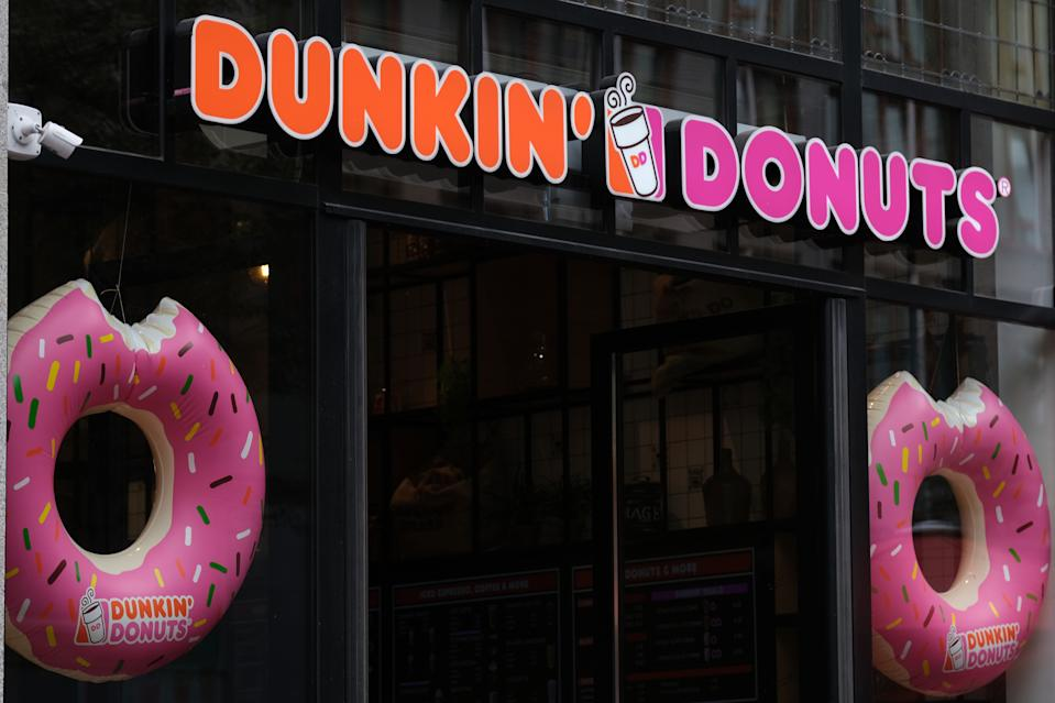 "THE HAGUE, NETHERLANDS - JULY 27: A logo of ""nDunkin' Donuts is seen at the entrance of its store on July 27, 2020 in The Hague, Netherlands.  (Photo by Yuriko Nakao/Getty Images)"