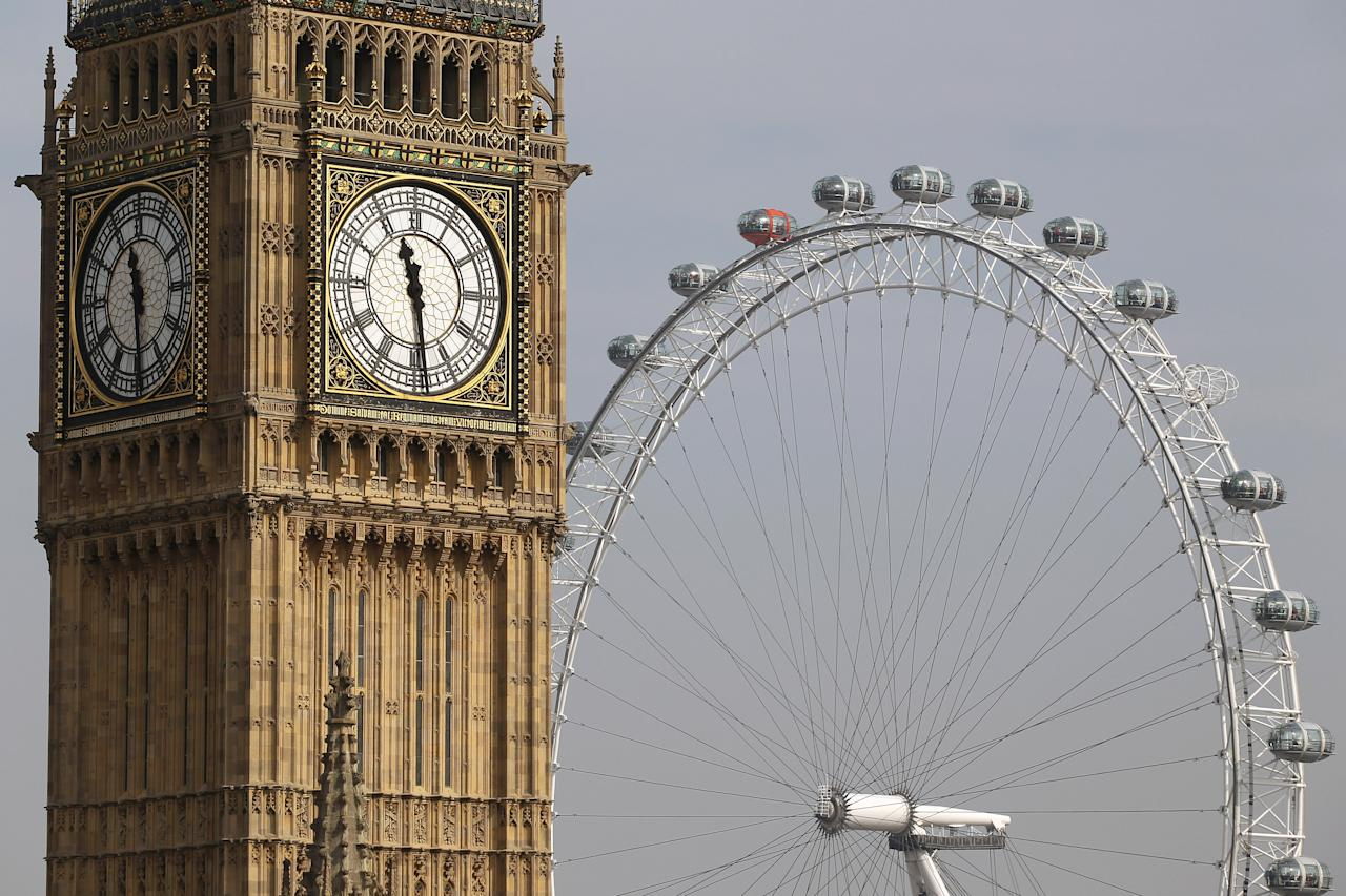 LONDON, ENGLAND - MARCH 22:  Clock Tower, also known as 'Big Ben,' rises in front of the London Eye on March 22, 2012 in London, England. A full rotation of the giant Ferris wheel, the largest of it's kind in Europe, takes 30 minutes and rises to a height of 135 metres. On a clear day one can see for 40km from the top.  (Photo by Dan Kitwood/Getty Images)