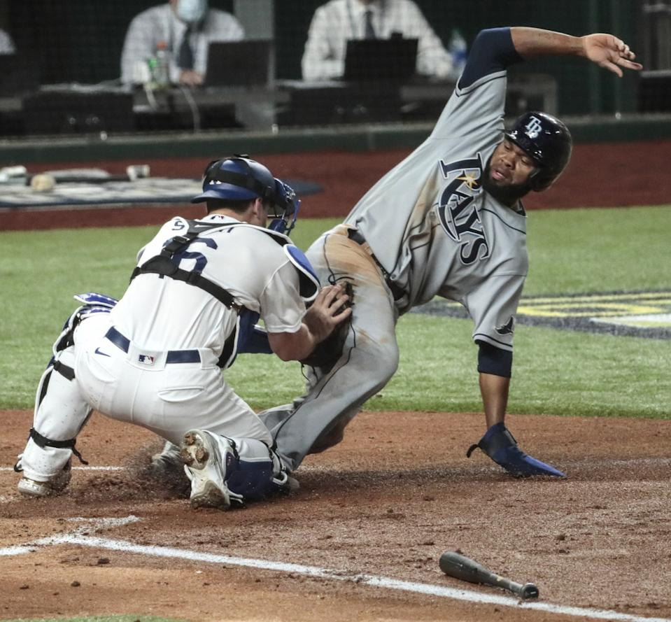 Tampa Bay Rays baserunner Manuel Margot is tagged out at home by Dodgers catcher Will Smith.