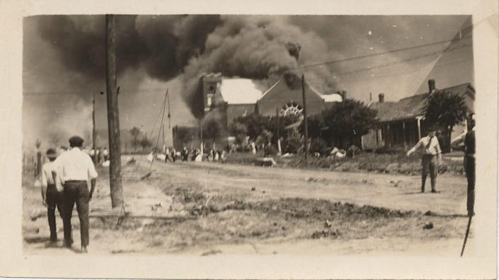 People watch the Mt. Zion Baptist Church burn, June 1, 1921.