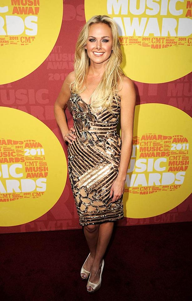 "Laura Bell Bundy struck a pose in a busy sequined number, which she paired with satin peep-toes. While the actress/singer usually looks pretty good at awards shows, this was not her best effort. Jeff Kravitz/<a href=""http://filmmagic.com/"" target=""new"">FilmMagic.com</a> - June 8, 2011"