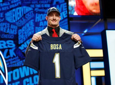 Apr 28, 2016; Chicago, IL, USA; Joey Bosa (Ohio State) after being selected by the San Diego Chargers as the number three overall pick in the first round of the 2016 NFL Draft at Auditorium Theatre. Kamil Krzaczynski-USA TODAY Sports