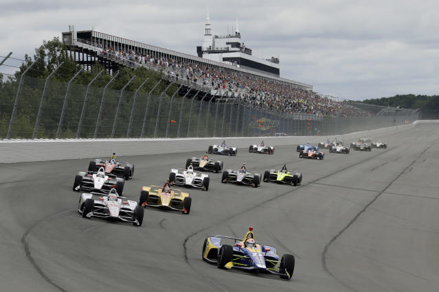 Alexander Rossi (27) leads the field into Turn 1 after a restart during the IndyCar auto race at Pocono Raceway, Sunday, Aug. 19, 2018, in Long Pond, Pa. (AP Photo/Matt Slocum)