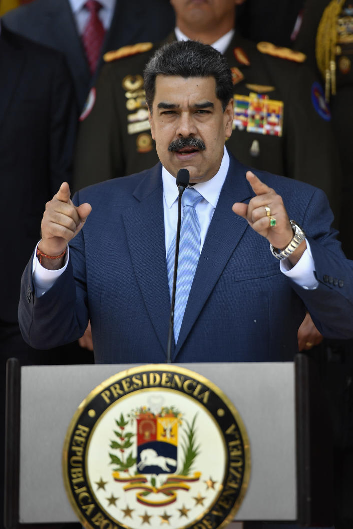 Venezuelan President Nicolas Maduro speaks at a press conference at the Miraflores Presidential Palace in Caracas, Venezuela, Thursday, March 12, 2020. Maduro has suspended flights to Europe and Colombia for a month, citing concerns for the new coronavirus. Maduro added in a national broadcast that the illness has not yet been detected in Venezuela, despite it being confirmed in each bordering country, including Colombia, Brazil and Guyana. (AP Photo/Matias Delacroix)