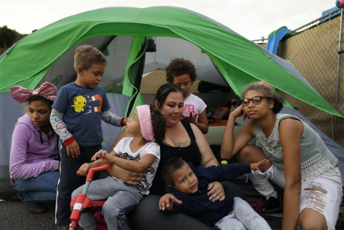 """<span class=""""caption"""">In 2017, a San Diego family was among several hundred people living in a campground for the homeless, set up to curb the worst hepatitis A outbreak in the United States in decades.</span> <span class=""""attribution""""><a class=""""link rapid-noclick-resp"""" href=""""http://www.apimages.com/metadata/Index/Homeless-Crisis-on-the-Coast-San-Diego/b0d09b99f82249138623efa6177d2e5f/33/0"""" rel=""""nofollow noopener"""" target=""""_blank"""" data-ylk=""""slk:Gregory Bull/AP Photo"""">Gregory Bull/AP Photo</a></span>"""