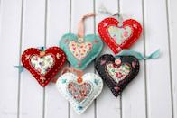 "<p>Use felt and fabric to create these charming heart-shaped gifts for Valentine's Day. Fill them with fiberfill and lavender so the sachets smell divine.</p><p><em><a href=""https://flamingotoes.com/diy-fabric-heart-valentines/"" rel=""nofollow noopener"" target=""_blank"" data-ylk=""slk:Get the how-to at Flamingo Toes»"" class=""link rapid-noclick-resp"">Get the how-to at Flamingo Toes»</a></em><br></p>"