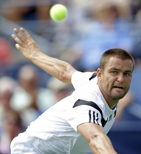Mikhail Youzhny, of Russia, returns a shot to Lleyton Hewitt, of Australia, during the fourth round of the 2013 U.S. Open tennis tournament, Tuesday, Sept. 3, 2013, in New York. (AP Photo/Kathy Willens)