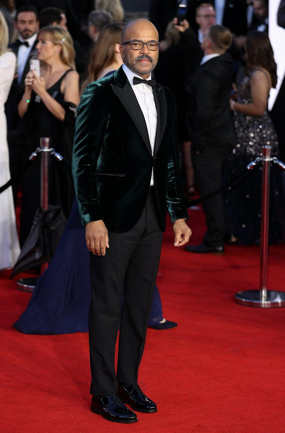 <p>Wright wore a tux with a green velvet jacket. </p>