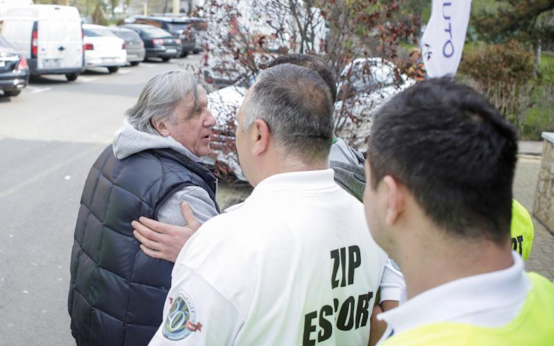 Ilie Nastase (L) is escorted off the arena's premises by stewards - REUTERS