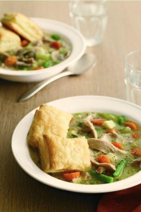 """<p>This healthier alternative to a classic chicken potpie has all the puff pastry goodness of the original with the hearty warmth that comes with a soup.</p><p><strong><em><a href=""""https://www.womansday.com/food-recipes/food-drinks/recipes/a11475/chicken-potpie-soup-recipe-122746/"""" rel=""""nofollow noopener"""" target=""""_blank"""" data-ylk=""""slk:Get the Chicken Potpie Soup recipe."""" class=""""link rapid-noclick-resp"""">Get the Chicken Potpie Soup recipe.</a></em></strong></p><p><strong><a class=""""link rapid-noclick-resp"""" href=""""https://www.amazon.com/AmazonBasics-Enameled-Covered-Dutch-6-Quart/dp/B073Q9K2H3/ref=sr_1_7?dchild=1&keywords=dutch+oven&qid=1606936195&sr=8-7&tag=syn-yahoo-20&ascsubtag=%5Bartid%7C10070.g.34837515%5Bsrc%7Cyahoo-us"""" rel=""""nofollow noopener"""" target=""""_blank"""" data-ylk=""""slk:SHOP DUTCH OVENS"""">SHOP DUTCH OVENS</a></strong></p>"""