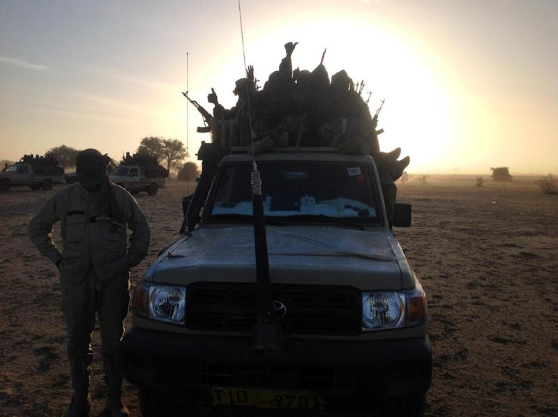 Soldiers of the Chadian army guard on January 21, 2015, the border between Nigeria and Cameroon, some 40 km from Maltam, as part of a military contingent against the armed Islamist group Boko Haram