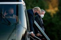 President Donald Trump walks off Marine One while arriving at Walter Reed Medical Center in Bethesda, Maryland on October 2, 2020