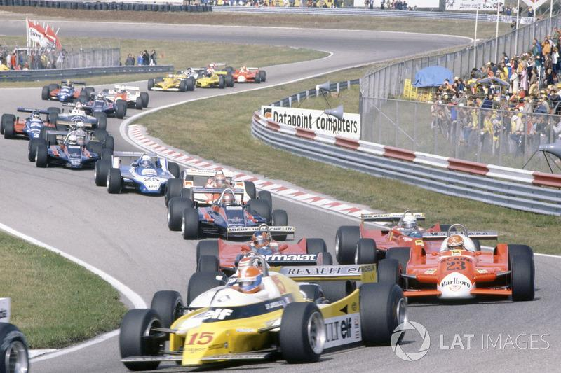 "Jean-Pierre Jabouille, Renault RE20, leads Nelson Piquet, Brabham BT49-Ford Cosworth, hidden, Bruno Giacomelli, Alfa Romeo 179B, Gilles Villeneuve, Jody Scheckter, both Ferrari 312T5, Mario Andretti, Lotus 81-Ford Cosworth, John Watson, McLaren M29C-Ford Cosworth, Didier Pironi, Ligier JS11/15-Ford Cosworth, Elio de Angelis, Lotus 81-Ford Cosworth, Riccardo Patrese, Arrows A3-Ford Cosworth, Jean-Pierre Jarier, Tyrrell 010-Ford Cosworth, Eddie Cheever, Osella FA1-Ford Cosworth, and Nigel Mansell, Lotus 81B-Ford Cosworth, at the start<span class=""copyright"">LAT Images</span>"