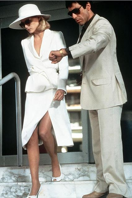 """<em><h2>Scarface (1983)</h2></em><br>You simply have not seen <em>froideur</em> until you have seen Michelle Pfeiffer as Elvira Hancock, Tony Montana's gak-snorting trophy wife, who swans around in a succession of immaculate outfits the color of her favorite drug. These are clothes for a woman who keeps her <a href=""""https://www.youtube.com/watch?v=jJS827RqN2A"""" rel=""""nofollow noopener"""" target=""""_blank"""" data-ylk=""""slk:pet tiger on a leash"""" class=""""link rapid-noclick-resp"""">pet tiger on a leash</a>.<span class=""""copyright"""">Photo: Courtesy of NBC Universal.</span>"""