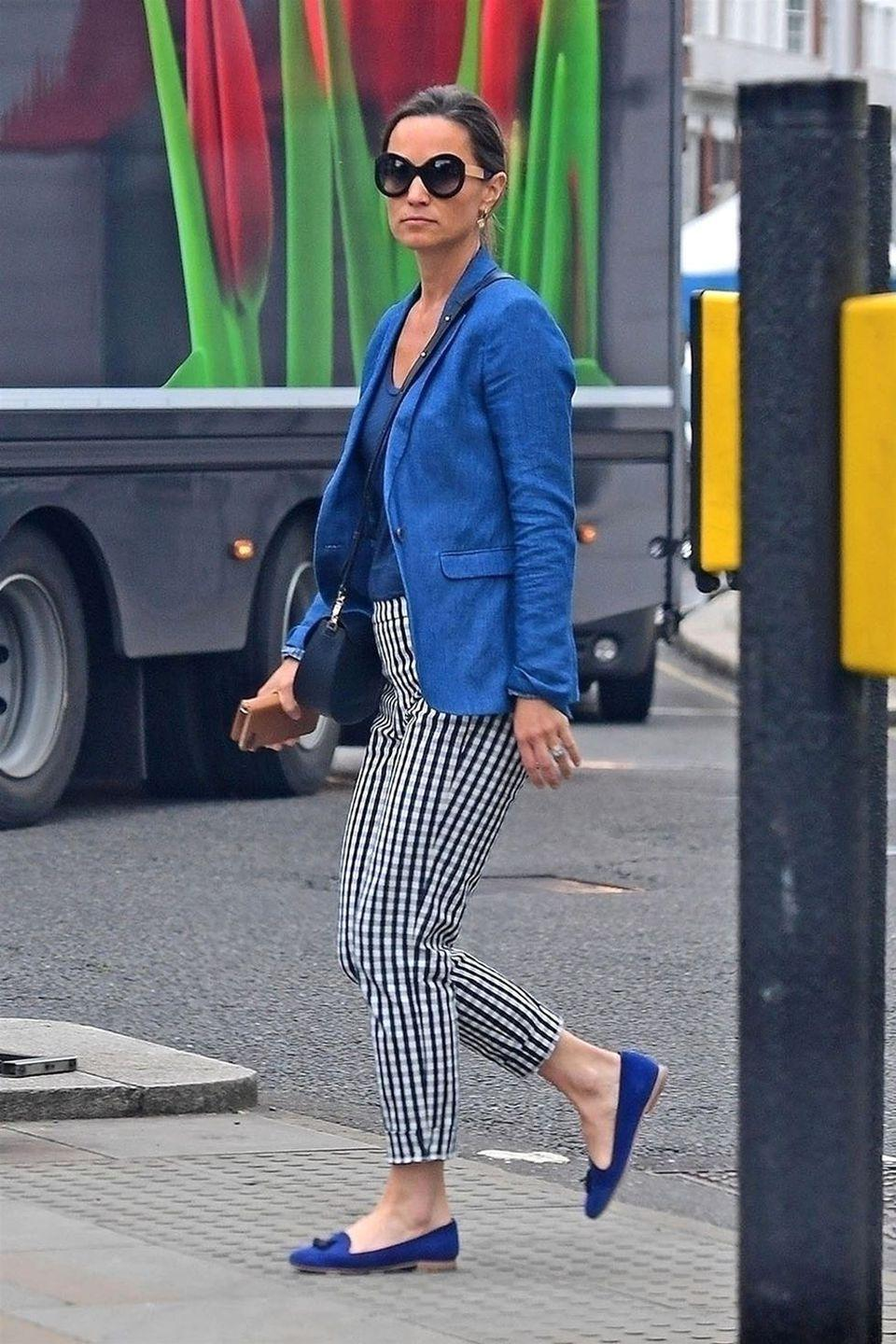 <p>In gingham pants, blue blazer and matching loafers. </p>