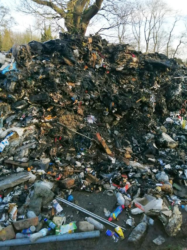 Four tonnes of waste, which stands 15ft high, was left in Watery Gate Lane, near Earl Shilton (Picture: SWNS)