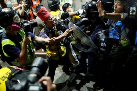 Anti-government protesters clash with the police near Yuen Long station, in Hong Kong