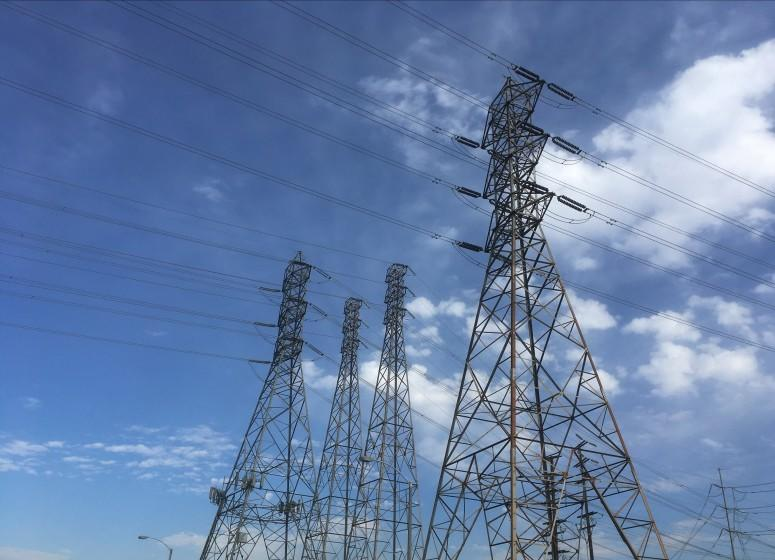 FILE - In this Saturday, Aug. 15, 2020, file photo, electrical grid transmission towers are seen in Pasadena, Calif. As if the pandemic and recession weren't bad enough, millions of Californians have been facing the recurring threats of abrupt blackouts during a heat wave in the nation's most populous state. (AP Photo/John Antczak, File)