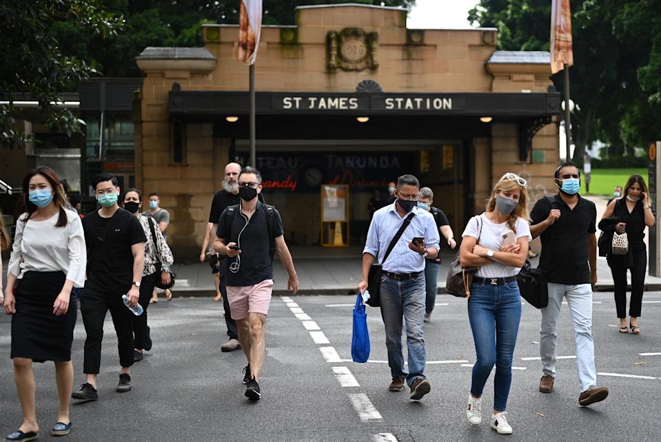 Commuters wearing face masks exit St. James Station in the CBD in Sydney on January 4. Source: AAP