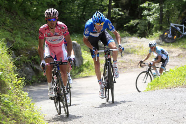 Canadian cyclist Ryder Hesjedal (C) and Spanish Joaquim Rodriguez (L) ride on Mortirolo uphill during the Tour of Italy cycling race Giro's 20th stage, a 219km ride from Caldes Val di Sole to Passo dello Stelvio, on May 26, 2012 in Passo dello Stelvio. AFP PHOTO/ POOL/ LUCA BETTINILUCA BETTINI/AFP/GettyImages