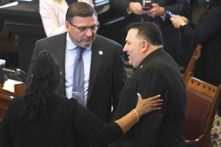 Kansas state Sen. Rick Kloos, center, R-Topeka, confers with Sens. Oletha Faust-Goudeau, D-Wichita, left, and Rob Olson, R-Olathe, right, before the start of a Senate session, Friday, April 9, 2021, in Topeka, Kan. Kloos is calling for a vote on removing Senate Majority Leader Gene Suellentrop, R-Wichita, following Suellentrop's arrest for drunken driving. (Andy Tsubasa Field/AP/Report for America)