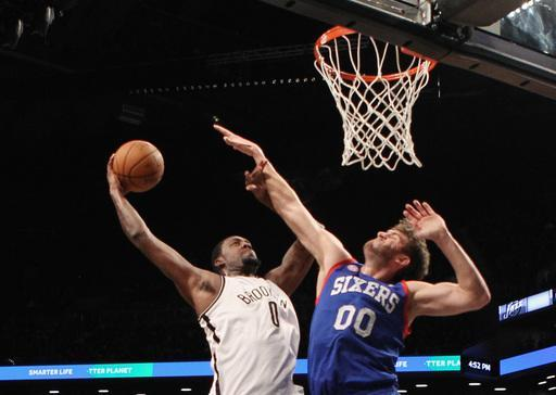 NEW YORK, NY - DECEMBER 23: Andray Blatche #0 of the Brooklyn Nets goes up for the dunk in the fourth but misses against Spencer Hawes #00 of the Philadelphia 76ers at Barclays Center on December 23, 2012 in the Brooklyn borough of New York City. (Photo by Bruce Bennett/Getty Images)