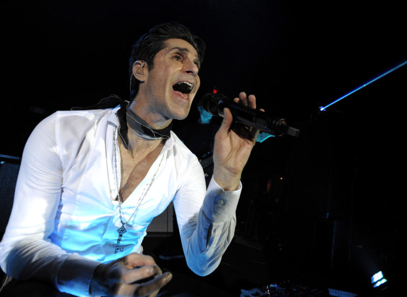 """FILE - This Nov. 8, 2011 file photo shows singer Perry Farrell of the rock band Jane's Addiction performing at the launch party for the video game """"The Elder Srolls V: Skyrim"""" in Los Angeles. Lollapalooza, starting Friday, Aug. 3, 2012, on Chicago's lakefront will have well-known headliners, like The Red Hot Chili Peppers and The Black Keys, but it also will have a special focus on dance music. Two electronic heavyweights, Avicii and Justice, will play main stage show this year. Festival founder and Jane's Addiction lead singer Perry Farrell said he looks at his more than 130-artist lineup as a guide to what's happening in music. (AP Photo/Dan Steinberg, file)"""