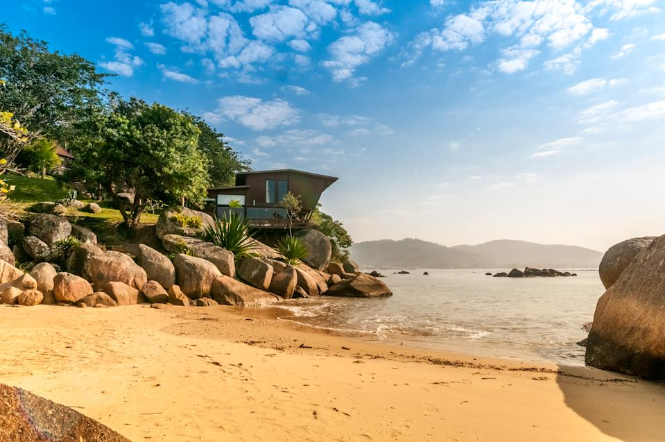 There's room enough for eight guests at this Brazilian beach house which boasts its own private beach. Photo: supplied.
