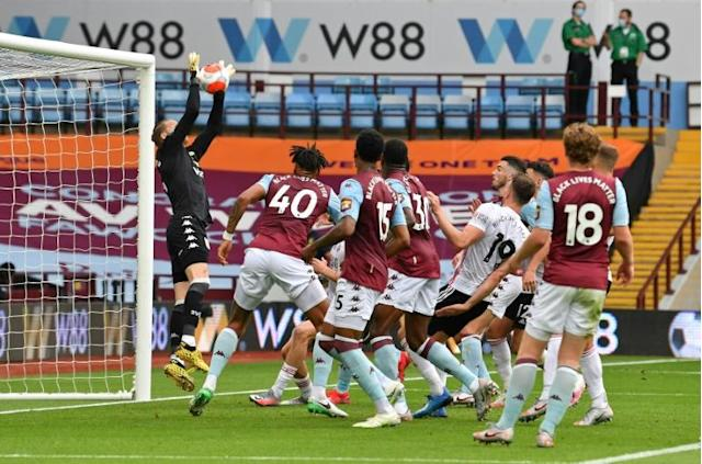 Aston Villa goalkeeper Orjan Nyland appeared to carry the ball over the line but no goal was given (AFP Photo/Paul ELLIS)