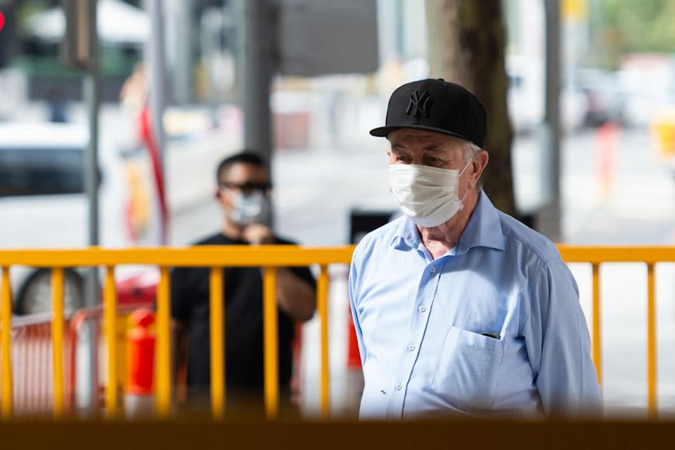 An elderly man wears a mask in Melbourne. Source: Getty