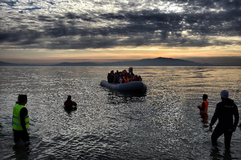 Refugees and migrants arrive on the northern island of Lesbos after crossing the Aegean sea from Turkey, on February 23, 2016 (AFP Photo/Aris Messinis)