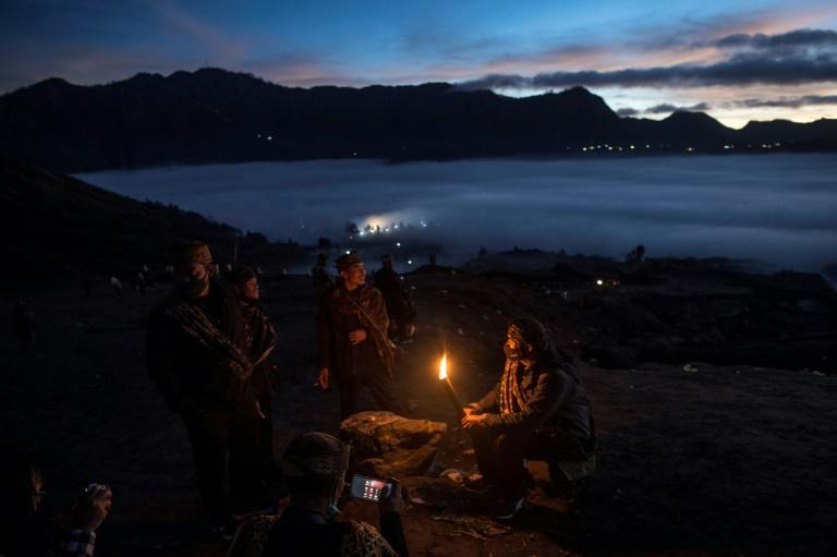 Tengger tribe people make their way to the summit of Mount Bromo to make offerings to the gods in Probolinggo, East Java, Indonesia