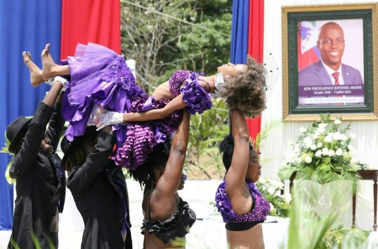 Haitian dancers perform during a ceremony in honor of murdered president Jovenel Moise