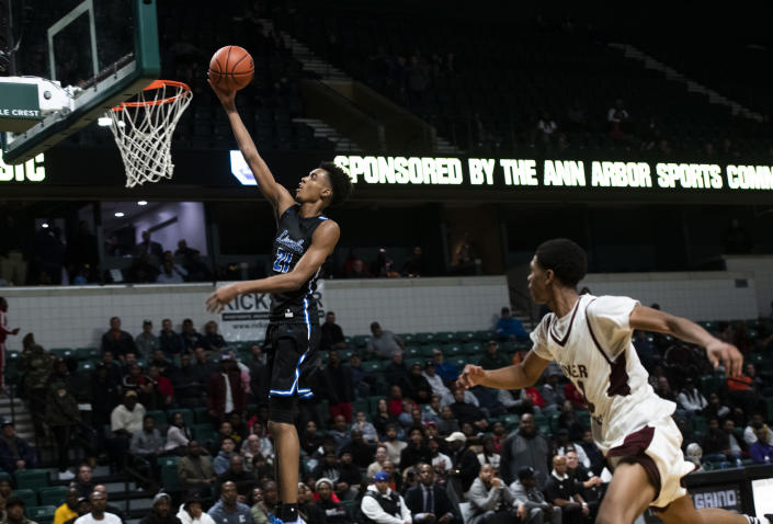 FILE - In this Dec. 9, 2019, file photo, Ypsilanti Lincoln's Emoni Bates shoots against River Rouge during the Tip Off Classic high school basketball game in Ypsilanti, Mich. Bates has committed to Memphis, adding another five-star recruit to coach Penny Hardaway's roster. Bates announced his decision Wednesday, Aug. 25, on Instagram after narrowing his choices to Michigan State, Oregon and the NBA's G League. The Michigan native committed to Tom Izzo and the Spartans last year before changing his mind in April. (Nicole Hester/Ann Arbor News via AP)