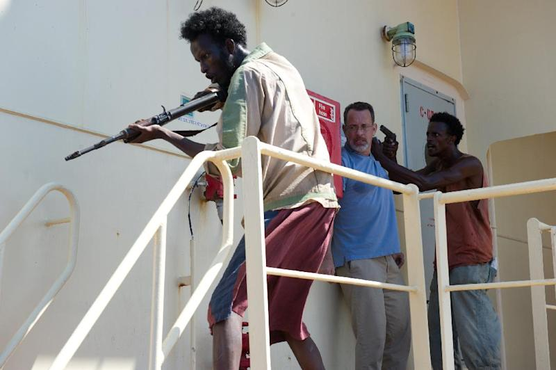 "This photo released by Sony - Columbia Pictures shows, from left, Mahat Ali, Tom Hanks and Faysal Ahmed, in a scene from the film, ""Captain Phillips,"" releasing in the US on Friday, Oct. 11, 2013. The amateur actors of Somali descent from Minneapolis made their film debut acting as Somali pirates alongside the two-time Academy Award winner, Hanks. (AP Photo/Copyright Sony - Columbia Pictures, Jasin Boland)"