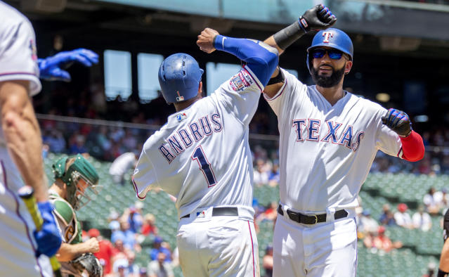 Texas Rangers' Nomar Mazara, right, is congratulated by Elvis Andrus (1) after hitting a two-run home run that scored Andrus off of Oakland Athletics starting pitcher Paul Blackburn during the third inning of the first baseball game of a doubleheader Saturday, June 8, 2019, in Arlington, Texas. (AP Photo/Jeffrey McWhorter)