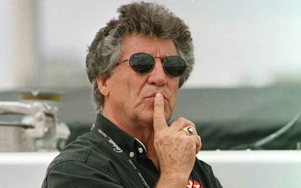 Retired racer Mario Andretti of Nazareth, Pa., watches as his son Michael runs his car during a practice round for Sunday's Bosch Spark Plug Grand Prix race Friday, April 24, 1998 at the Nazareth Speedway in Nazareth - Credit: Chris Gardner/AP Photo