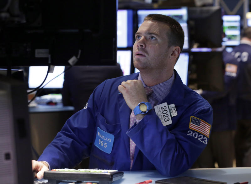 FILE - In this Monday, Sept. 16, 2013, file photo, specialist Frank Masiello works on the floor of the New York Stock Exchange. (AP Photo/Richard Drew, File)